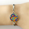 Image of Autism Awareness 'Take Care' Colorful Puzzle Pieces Bracelets