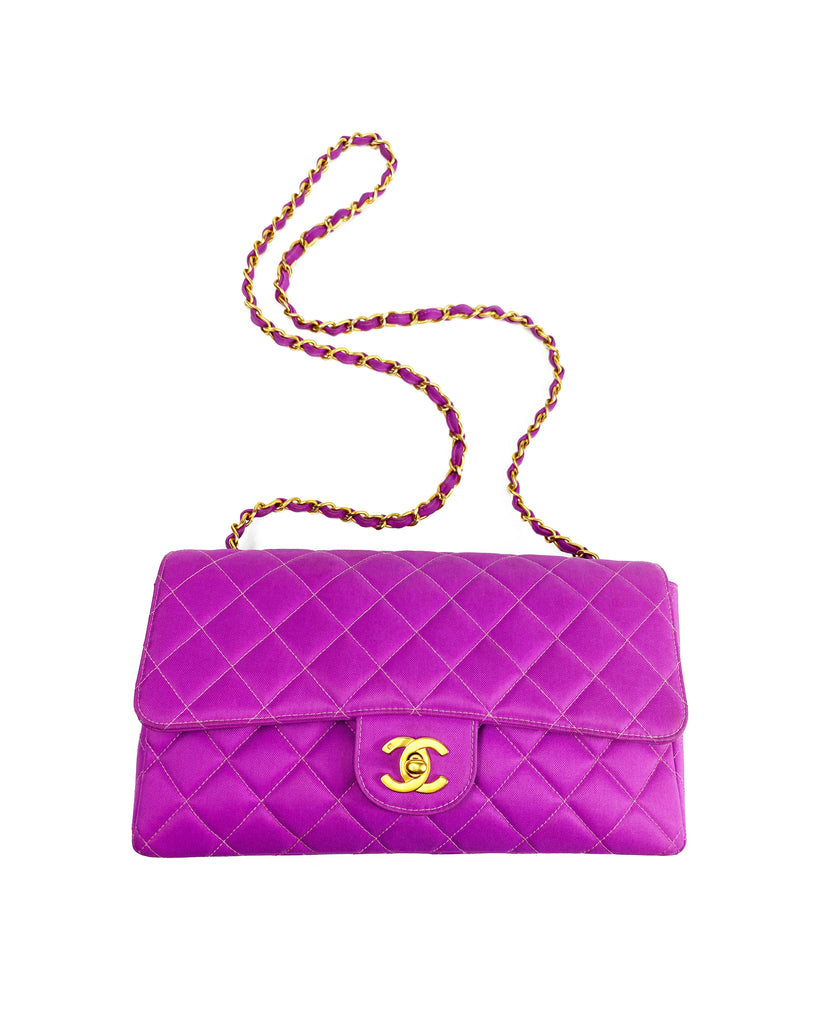 Fruit Vintage classic Chanel quilted nylon flap bag in extremely rare purple nylon, dating to 1995. Features the classic Chanel flap structure with contrast pale purple stitching and matte gold hardware.