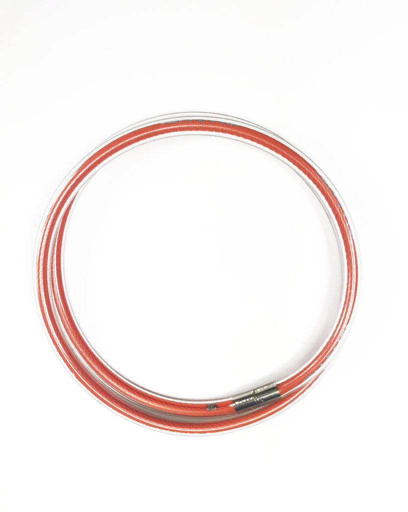 Fruit Vintage Chanel orange wrap around rubber tubing choker with CHANEL text logo all around.