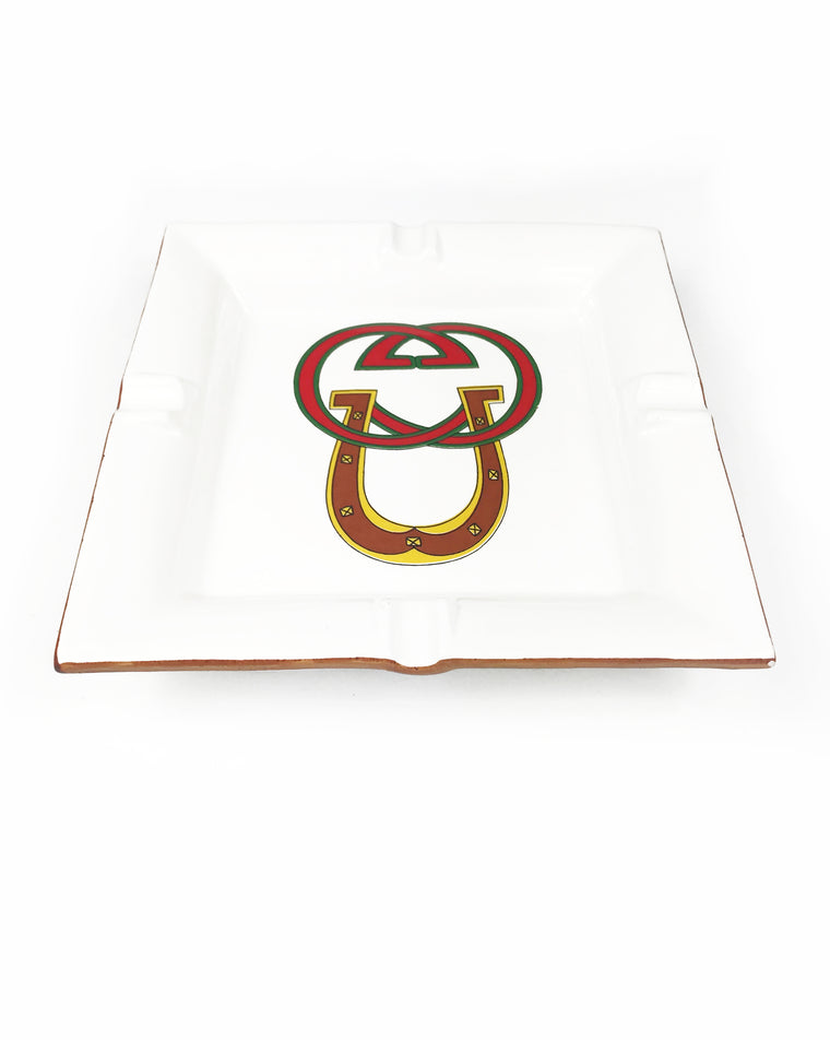 FRUIT Vintage Gucci hand painted 1980's porcelain logo ashtray or change tray. Features a classic ashtray shape, brown trim and Gucci suede logo fabric and mark at base. This is a very special piece!