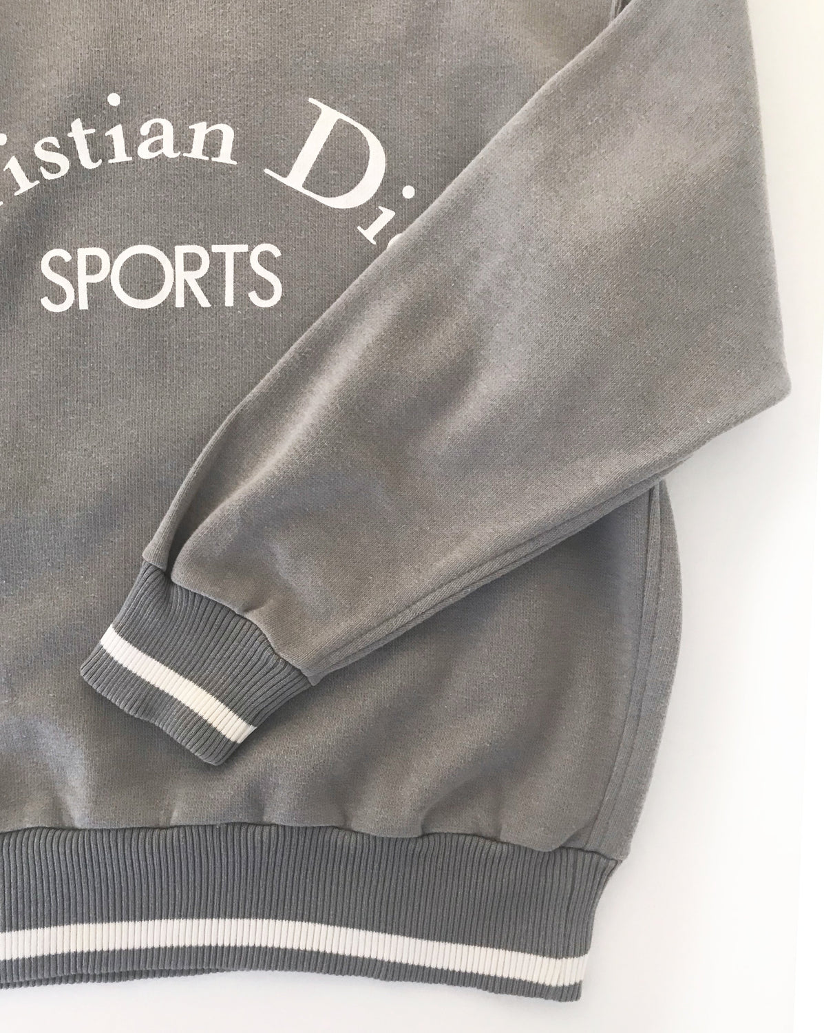 Fruit Vintage Christian Dior Sport Grey 1980s Logo sweat shirt. It features a large printed logo design at front and classic sweat shirt cut.