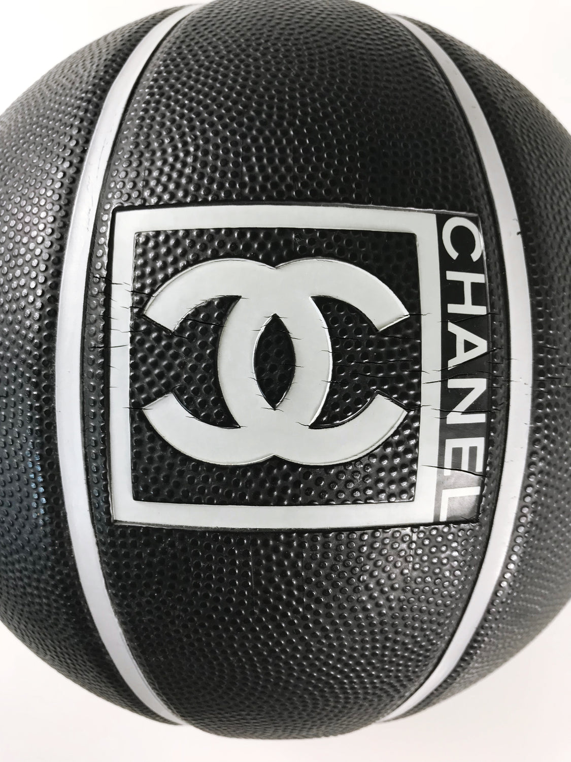 Fruit Vintage rare Chanel 2004 Basketball. This Chanel sport logo ball by Karl Lagerfeld is an important Chanel collectors accessory. It features a large Chanel logo and text on both sides in high contrast grey/black tone. Perfect for use as a home decor feature, this ball is piece of Chanel history!