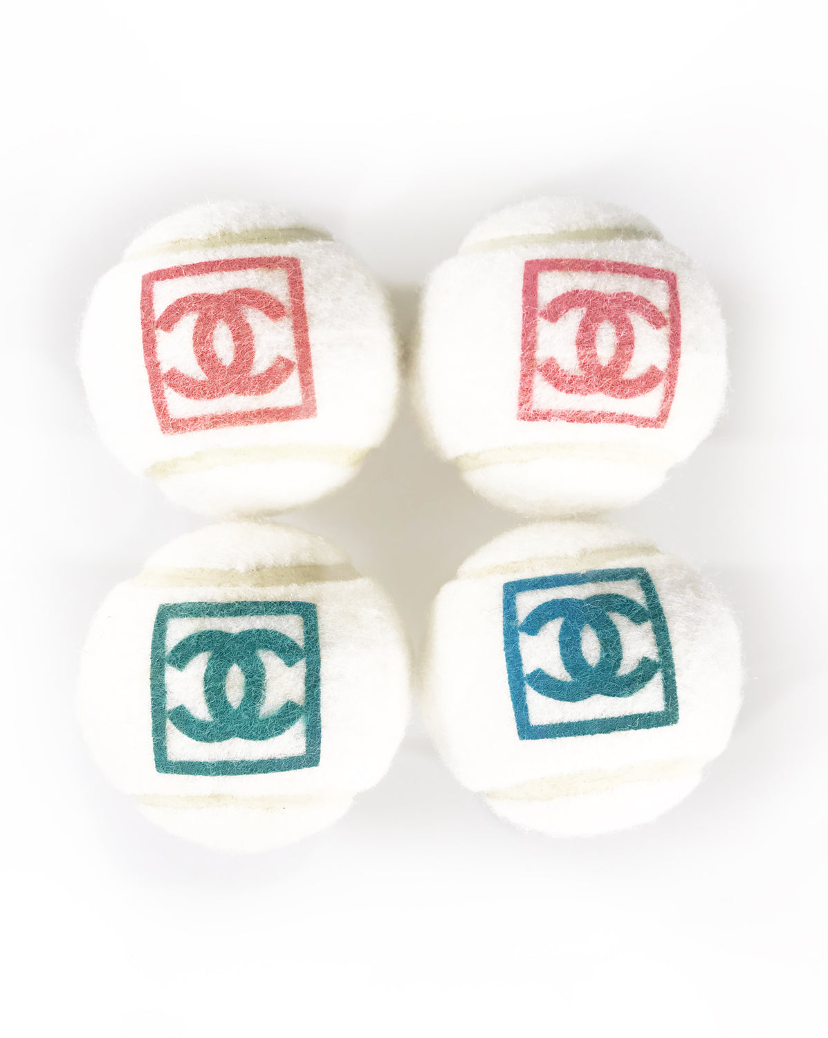 Fruit Vintage Chanel tennis ball set - a rare and important Chanel collectors accessory. It features a 4 Chanel tennis balls (2 pink and 2 blue) in a navy zipper accessory pouch with logo embroidery.
