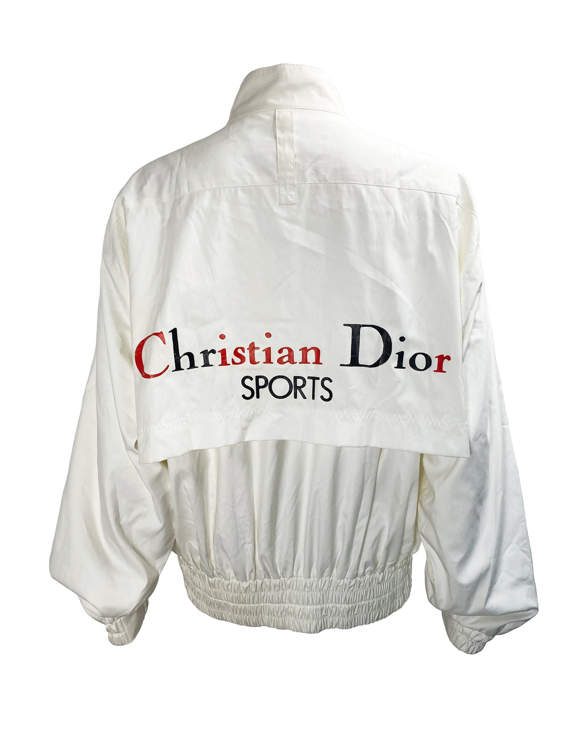 FRUIT Vintage  rare Christian Dior Sport Logo bomber jacket from the 1980s. It features a classic 1980s bomber jacket cut with over flap and large Christian Dior Sport text logo printed at rear.