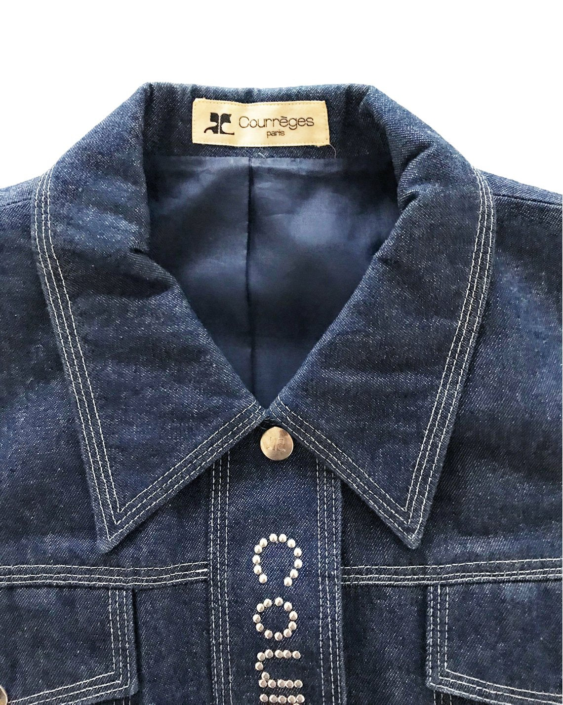 Fruit Vintage Courreges denim logo dress. Features a large silver logo at front, top stitching and logo buttons. Can also be fully unbuttoned and worn as coat/duster jacket.