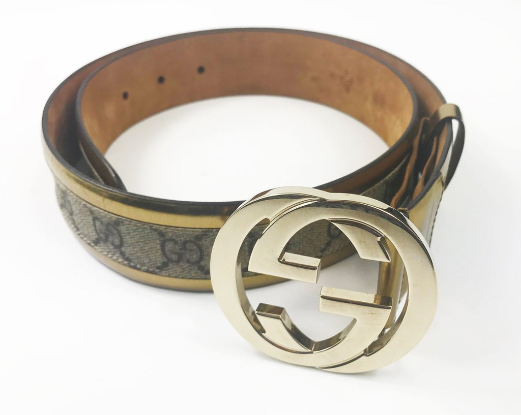 FRUIT Vintage Gucci 1990s logo belt featuring gold leather trim, classic Gucci coated canvas and a large Gucci double G buckle at the front.