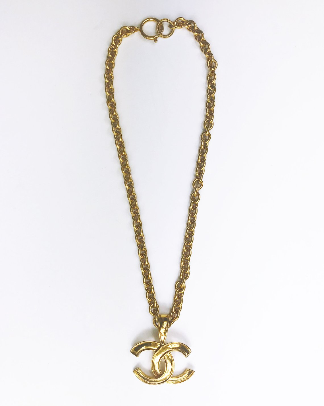 aac96682241 Fruit Vintage Chanel logo pendant necklace dating to 1994. Features a thick  gold chain and