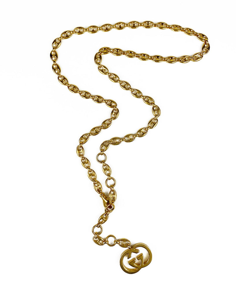 Fruit Vintage Gucci 1980s logo chain belt in classic gold. Features a lobster clip closure and significant logo drop Gucci GG charm. Looks incredible when worn as a necklace.