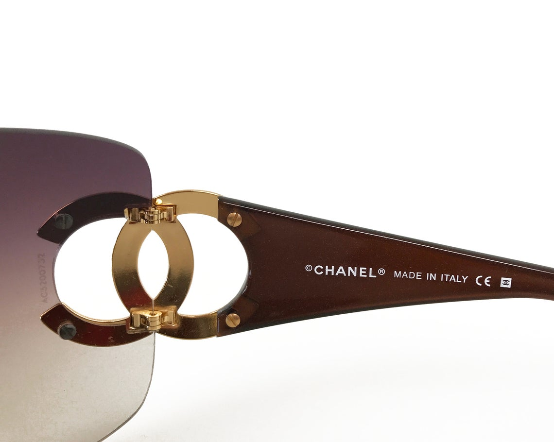Fruit Vintage Chanel large Y2K logo sunglasses. They feature big Chanel CC logo monograms to each side and a classic early 2000s shield shape.