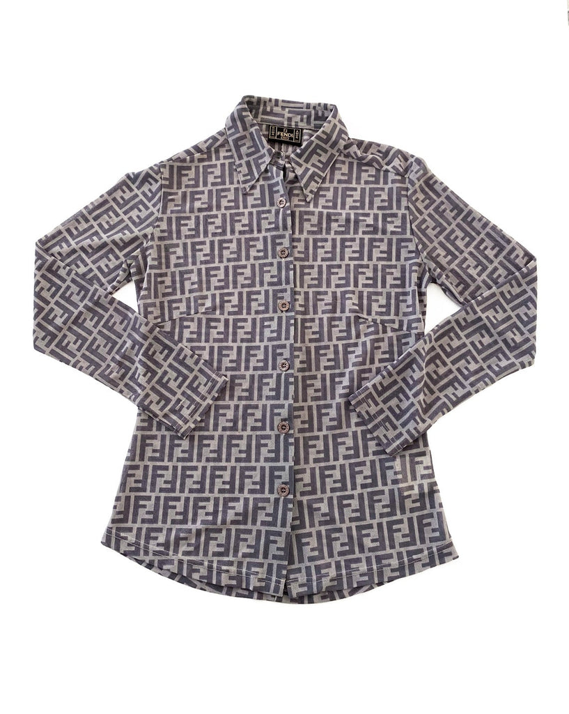 FRUIT Vintage Fendi Zucca print button up shirt dating to the early 90s. This amazing piece is made from a sheer mesh and features a bold Fendi Zucca print in two tone grey.