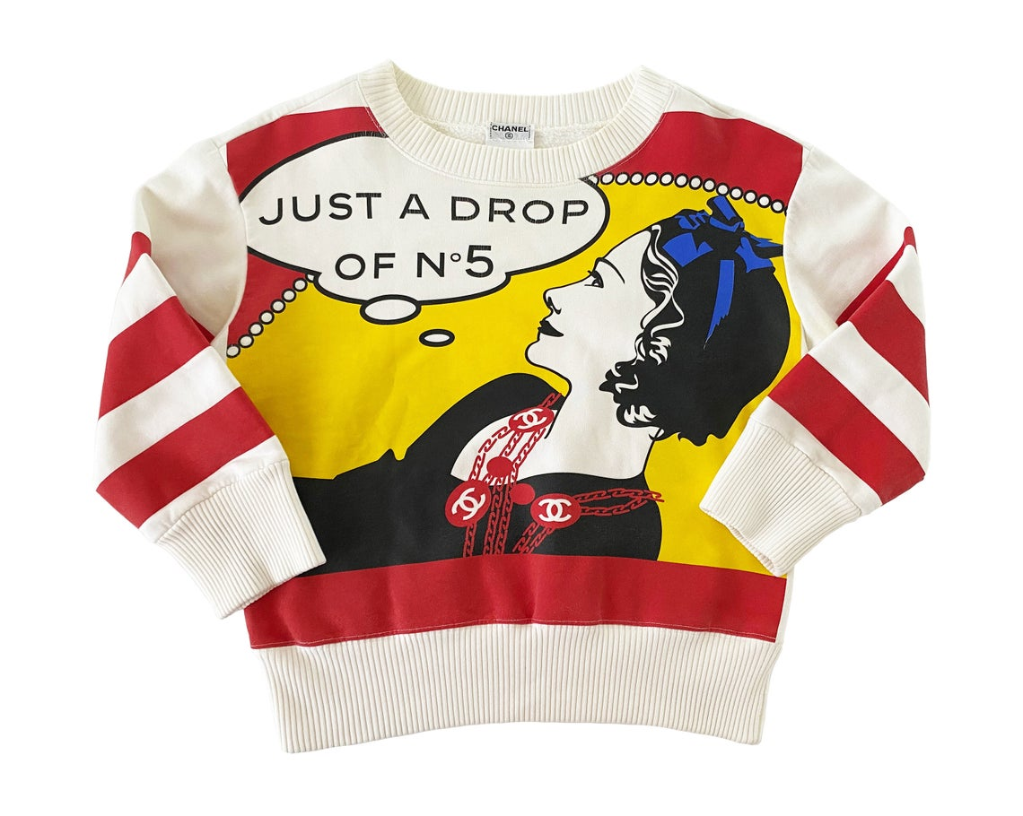 "FRUIT Vintage rare and important Chanel ""Just a Drop of No. 5"" sweatshirt from the Fall 2001 collection. It features a pop art Roy Lichtenstein inspired graphic art print of Coco Chanel and a cropped design and sleeves."