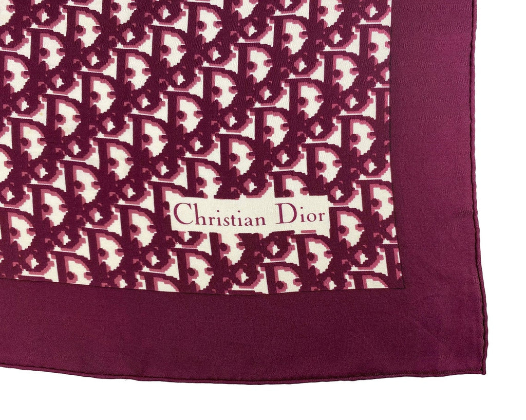 Fruit Vintage Christian Dior oblique print silk scarf in deep red/maroon. Features a bold graphic Dior logo print and hand finished rolled hem edging.