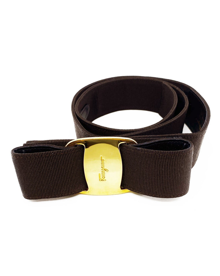 Fruit Vintage Salvatore Ferragamo 1980s bow belt in dark brown gross grain fabric. It features the iconic Ferragamo bow design with a large logo plate at front.