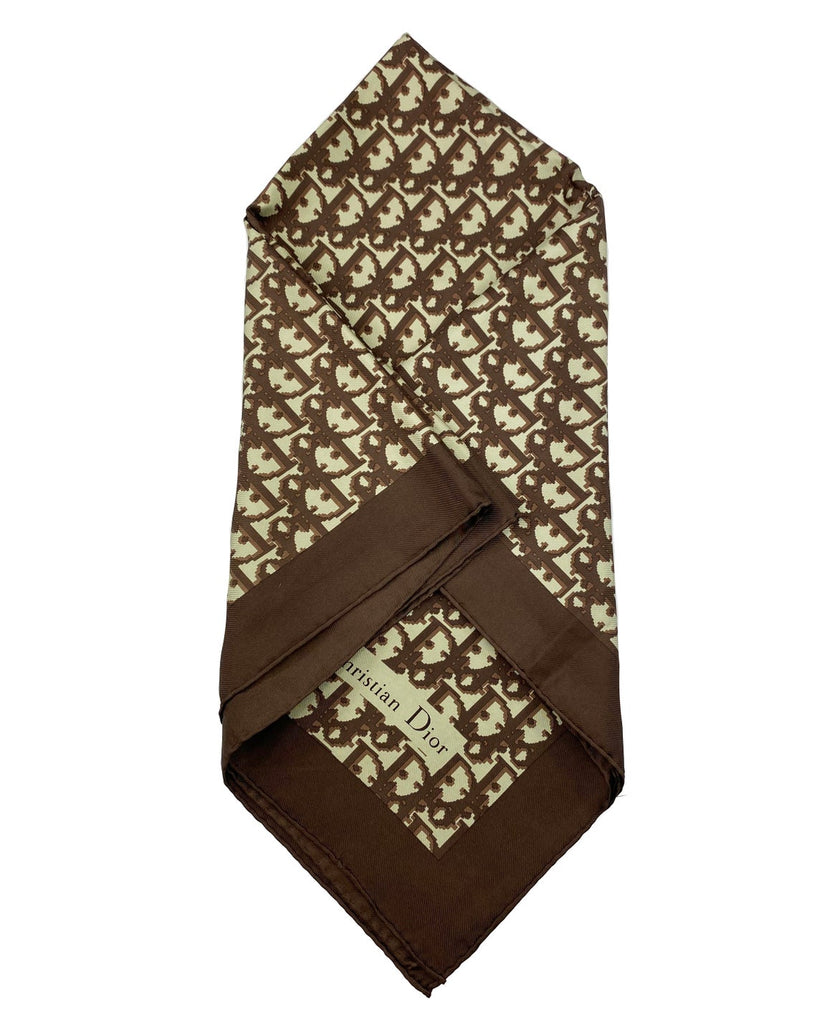 Fruit Vintage Christian Dior oblique print silk scarf in brown. Features a bold graphic Dior logo print and hand finished rolled hem edging.