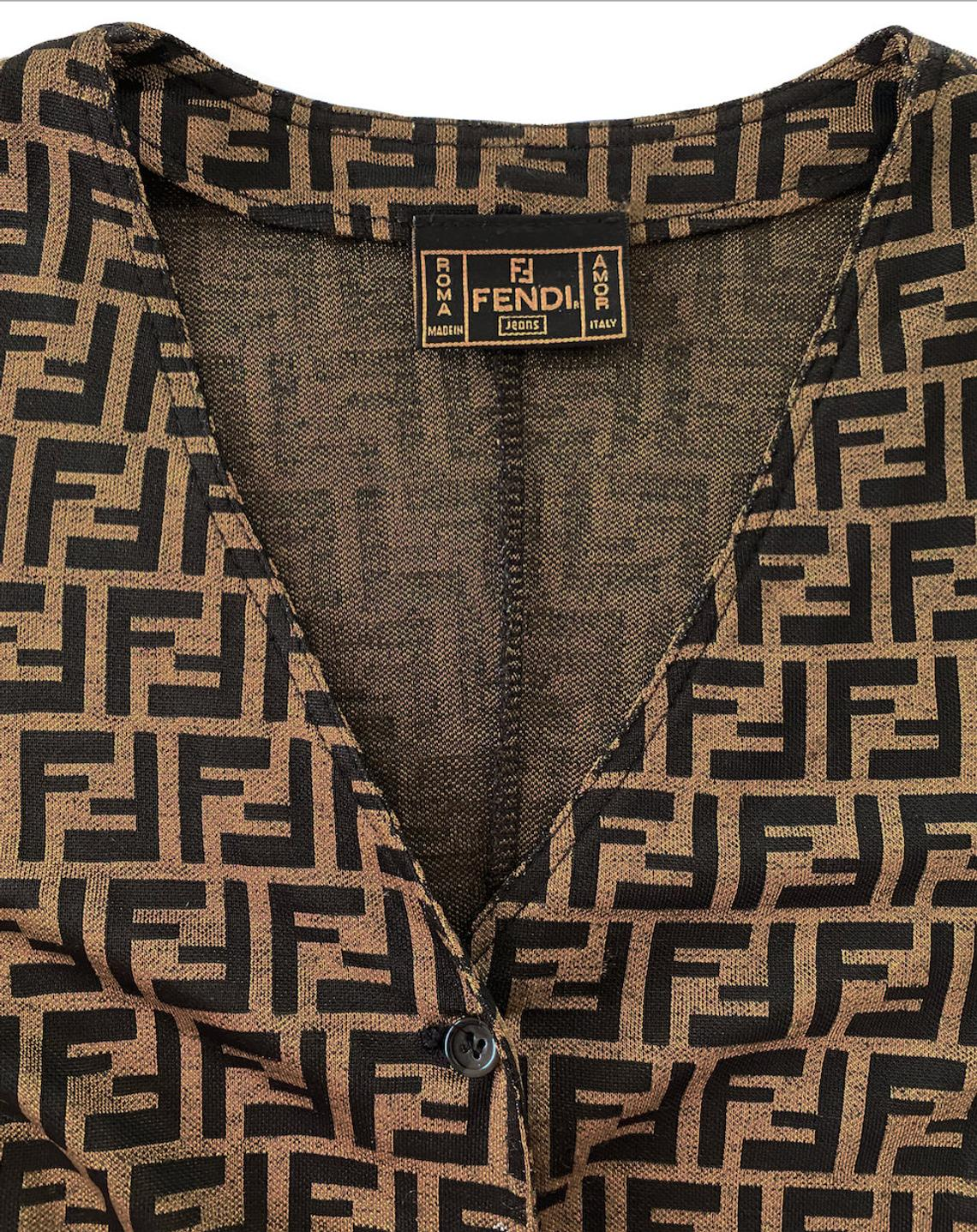 FRUIT Vintage 1990s Fendi Zucca Print Logo Button Up Cardigan. Features a classic button up front and cardigan shape and graphic Fendi FF logos all over.