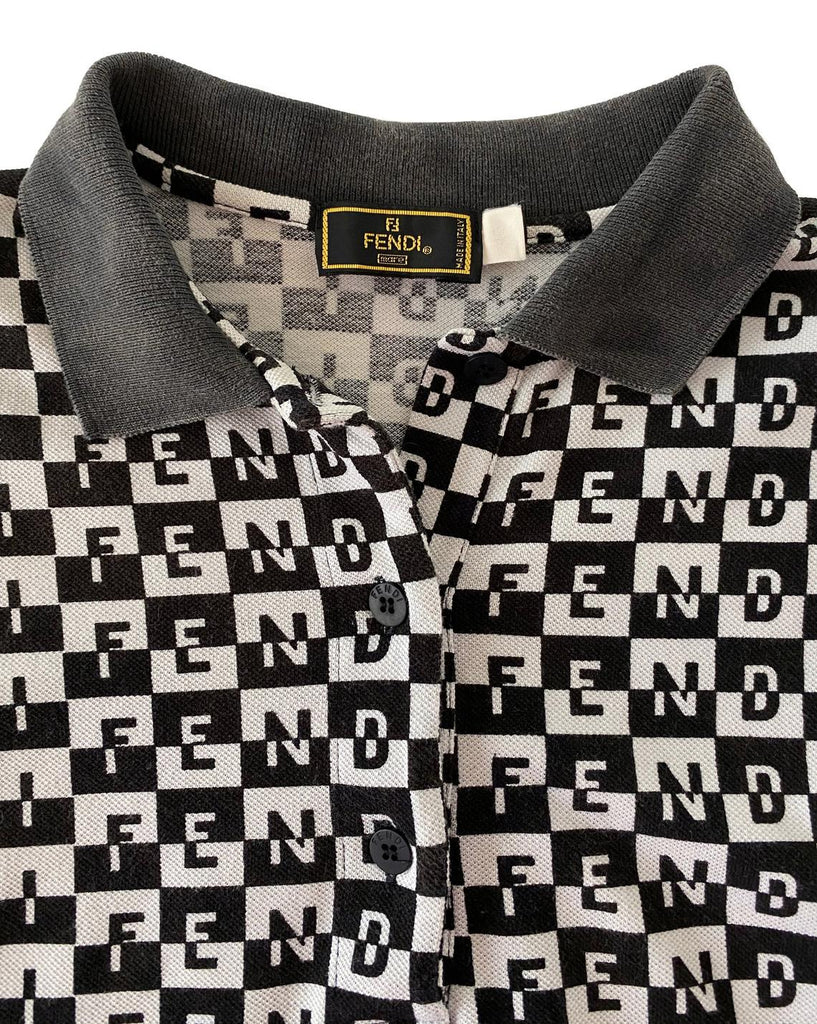 Fruit Vintage Fendi logo dress dating to the 90s, it features a polo shirt dress cut and a bold Fendi Logo print in black and white.