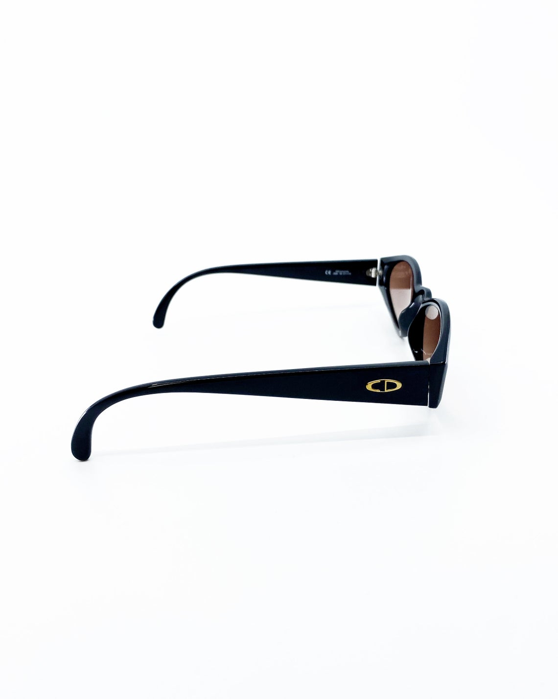 Fruit Vintage Christian Dior sunglasses dating to 1990. These small oval frames feature a gold trim over the nose and CD logo to each arm.