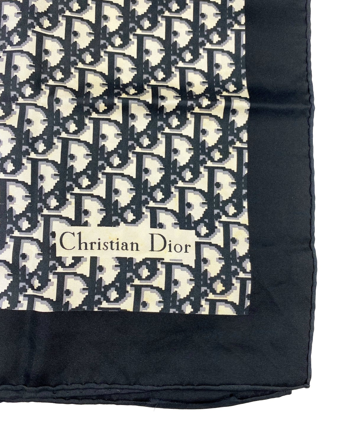 Fruit Vintage Christian Dior oblique print silk scarf in black and grey. Features a bold graphic Dior logo print and hand finished rolled hem edging.