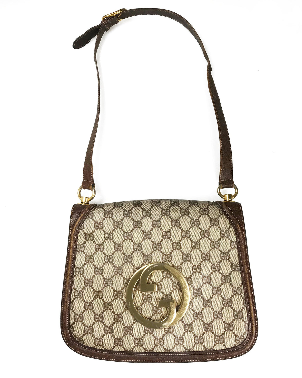 FRUIT Vintage Gucci 1973 Blondie logo monogram canvas shoulder bag features a very large front double G Gucci Logo at the front, a classic flap closure, brown leather trim and internal zipper pocket.