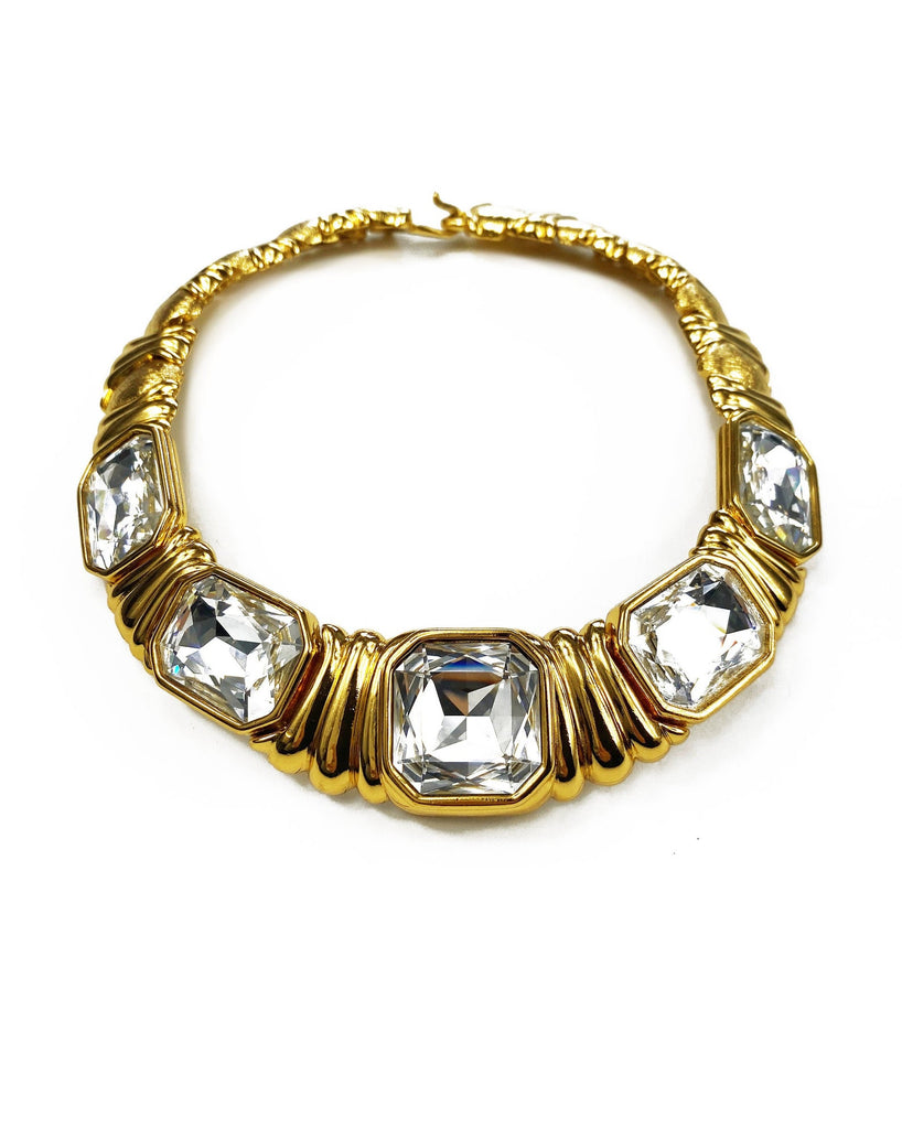 Fruit Vintage 1980s Yves Saint Laurent crystal collar choker necklace. It features 5 very large cut glass/crystals, heavy gold plating in a deep yellow tone and a reticulated moving design.