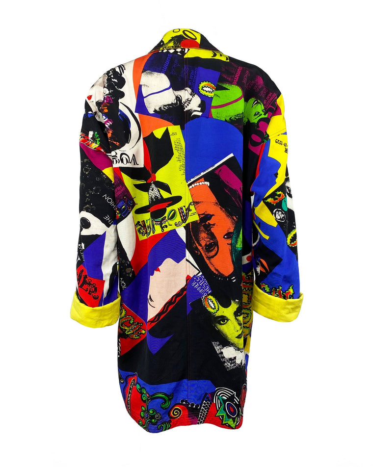 FRUIT Vintage Gianni Versace Vogue print coat from the iconic Spring 1991 runway collection. It features the iconic Vogue print in large scale all over and is fully reversible with a yellow cotton lining. This coat is a true piece of fashion history!
