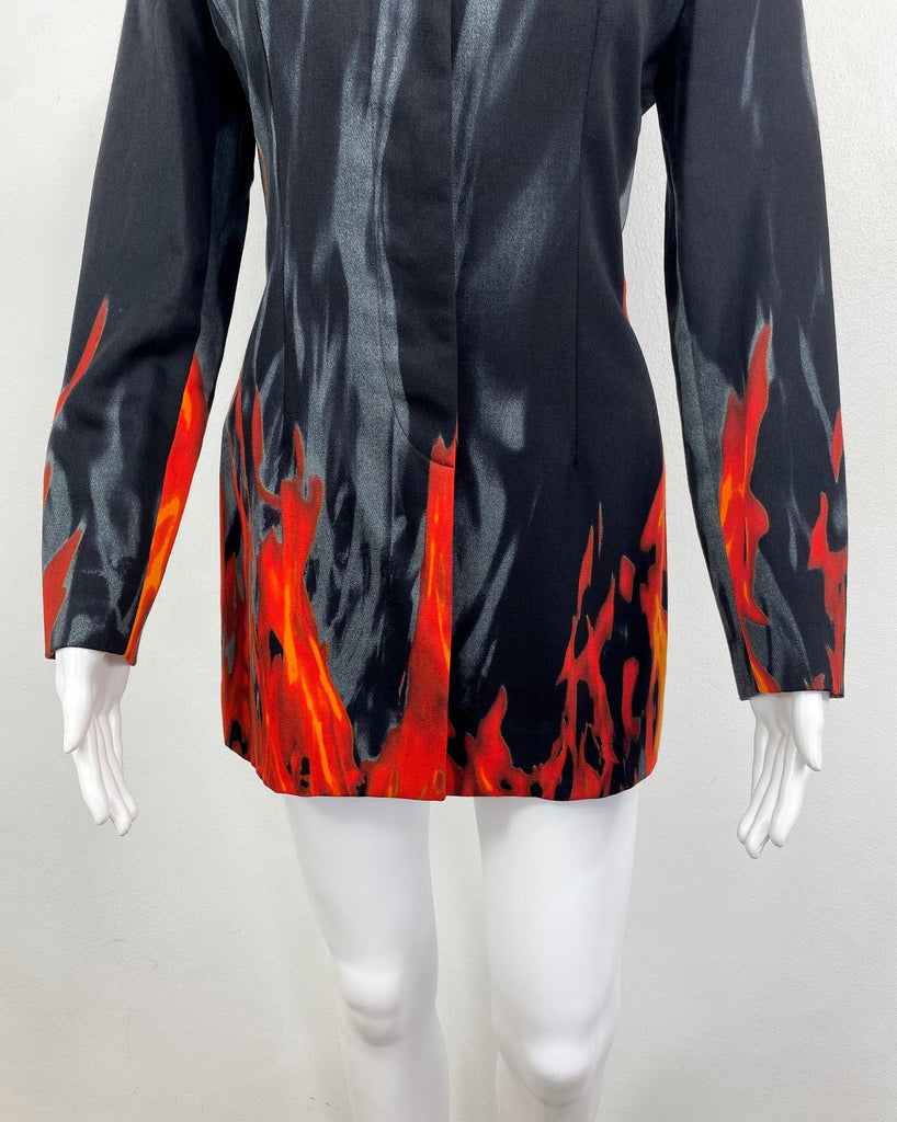 FRUIT Vintage Moschino 90s Flame Jacket as worn by Fran Drescher on the Nanny! It features a flame and smoke print on the hem line and sleeves going up the jacket.