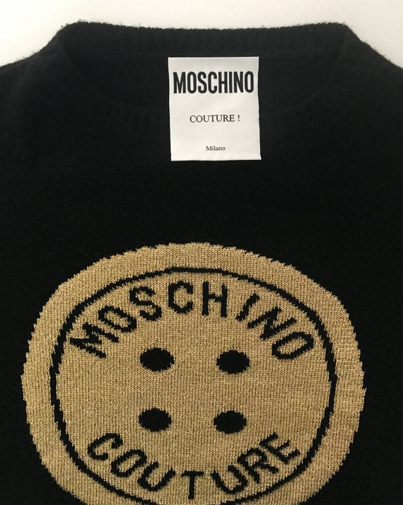 FRUIT Vintage Moschino Couture knit sweater from the 1990s. This amazing piece is made from a super soft wool/cashmere blend with an large intarsia style knitted gold front Moschino monogram logo
