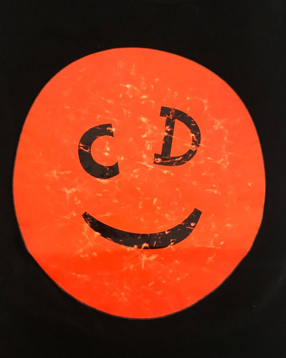 Fruit Vintage Christian Dior Smiley face logo tee printed with a neon orange smiley face with CD logo eyes.