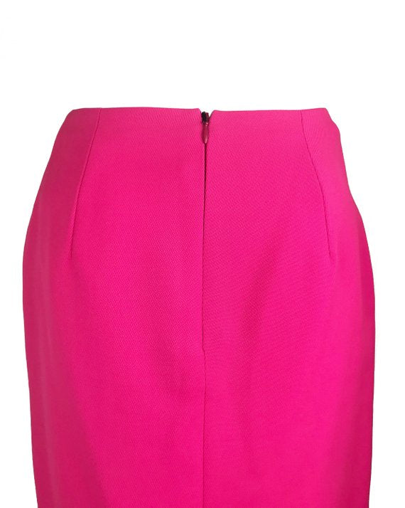 FRUIT Vintage neon pink lifetime Gianni Versace skirt with the original tags still attached. This piece dates to 1996 and features a classic slim fit and high waist design.