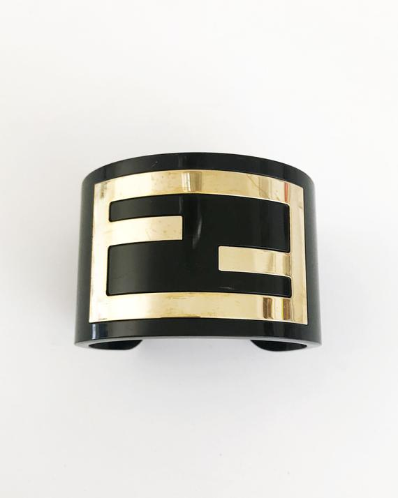 FRUIT Vintage Fendi Zucca Monogram Logo Cuff Bracelet. Featuring large brass Fendi logo F's set in black perspex.