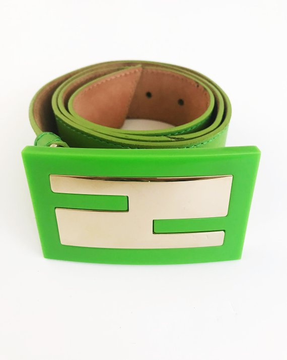 FRUIT Vintage Fendi Zucca Monogram Logo belt. It features a large Fendi logo buckle made from brass and perspex in awesome neon green.