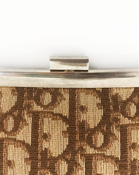 FRUIT vintage 1970s Christian Dior clutch bag is made of Brown oblique monogram logo trotter print canvas and features a gold hardware clip top closure.