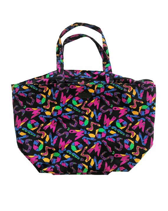 Fruit Vintage 1980s Missoni beach bag in a psychedelic logo printed nylon fabric. Features a zipper closure at top and internal zipped pocket.