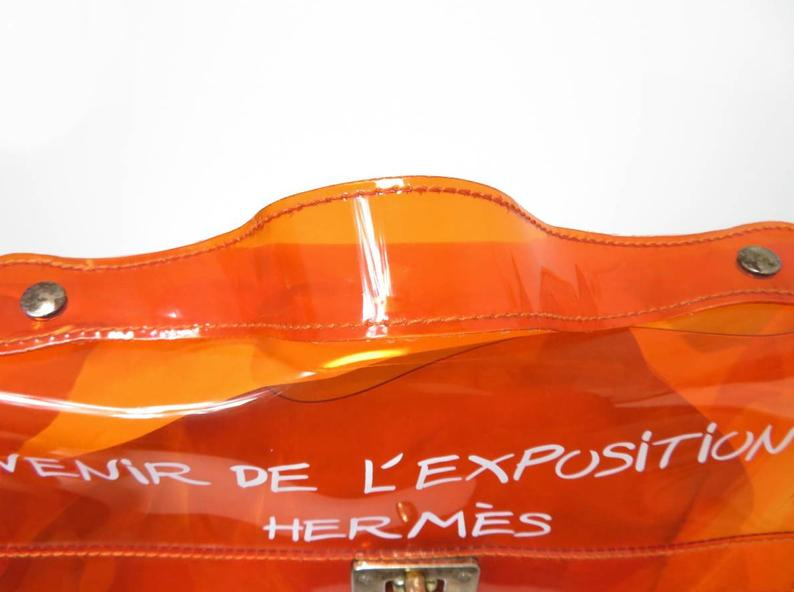 Fruit Vintage Souvenir Hermes Clear orange Kelly bag dating to 1998. Originally sold by Hermes as a very limited edition souvenir piece to celebrate the opening of a special Hermes boutique in Japan in 1998, these are highly collectable as seen on Ariana Grande and Kim Kardashian.