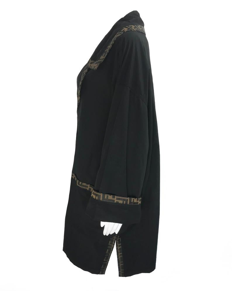 FRUIT Vintage Fendi 1990s oversized cocoon coat with iconic Zucca logo print trim.