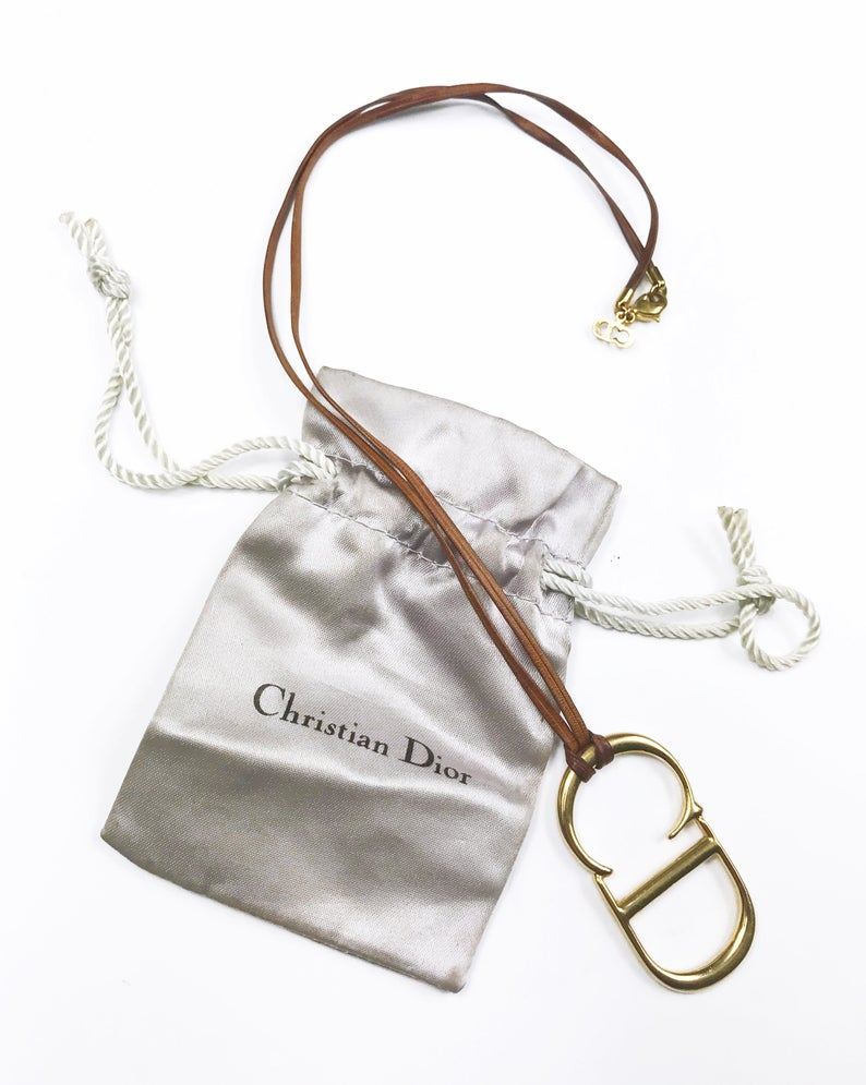 Fruit Vintage Christian Dior CD logo monogram pendant necklace on leather strap.