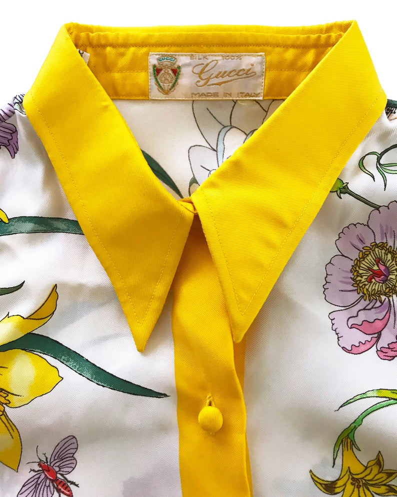 FRUIT vintage rare Gucci silk flora print shirt dating to the 1980s. It features the classic Gucci flora design from the era trimmed with vibrant yellow. This is a true piece of Gucci history!