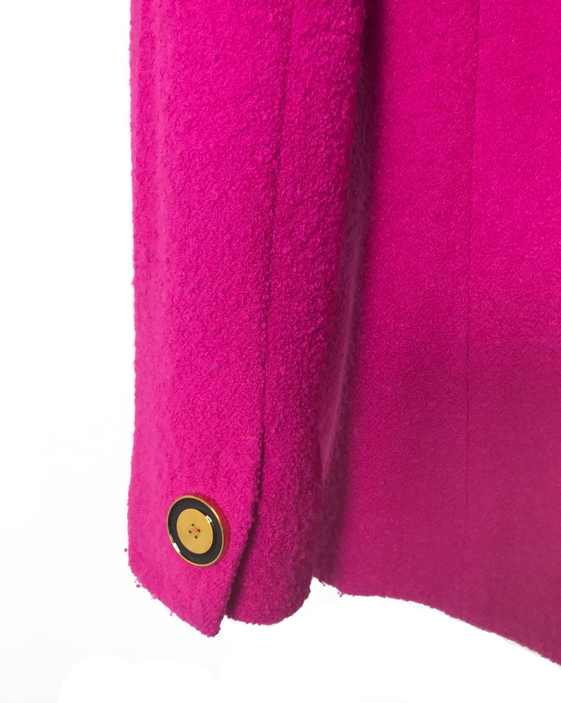 A fabulous bright pink Givenchy jacket dating to the 1980s. This bright piece features a contrast grey trim and large gold buttons.