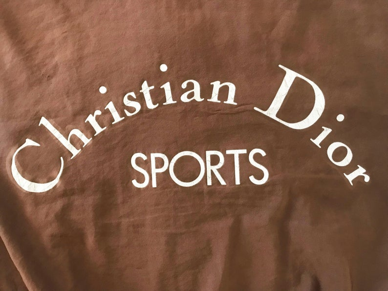 FRUIT vintage rare Christian Dior Sports Logo bomber jacket from the 1980s. It features a classic 1980s bomber jacket cut, and large Christian Dior Sport text logo printed at rear.