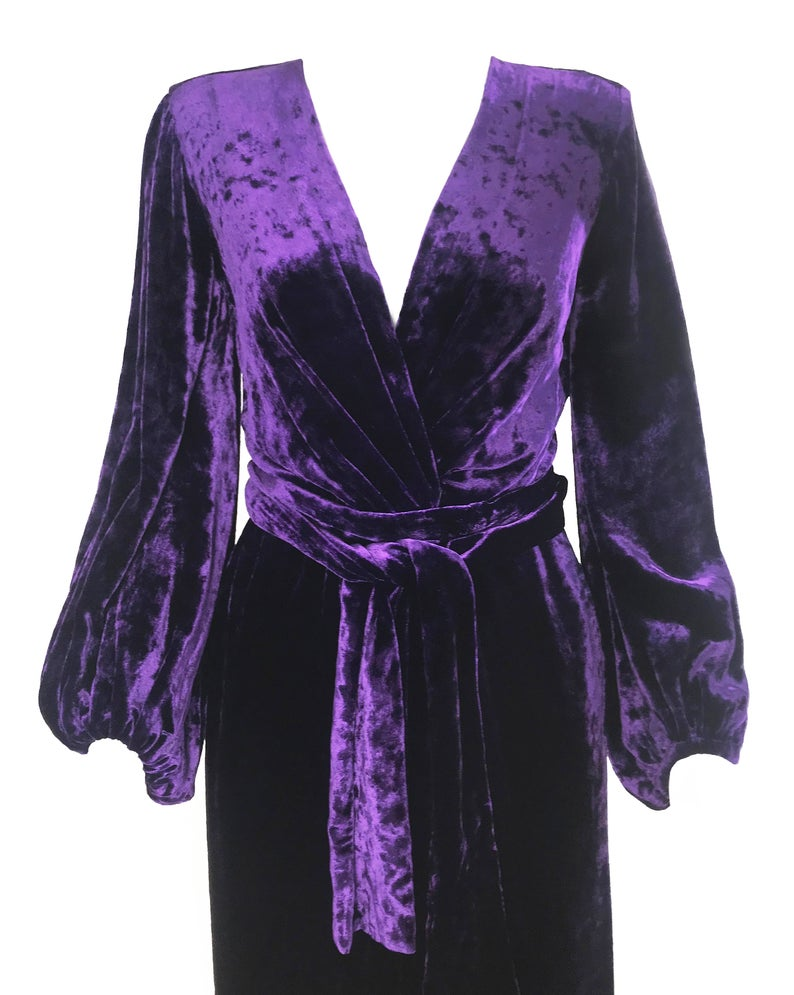 FRUIT Vintage Yves Saint Laurent Rive Gauche purple velvet gown dating to the 1970s. YSL dress features a plunging neckline, gorgeous 70s bell sleeves and removable wrap tie belt. It can be worn as a dress or unclipped and worn as a duster jacket/robe.