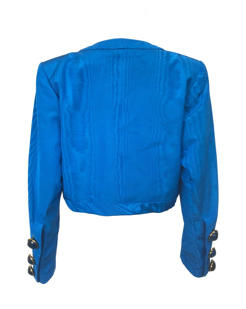 FRUIT Vintage Yves Saint Laurent Rive Gauche turquoise blue crop jacket dating to the 1980s. In near mint condition, this amazing piece features bright green lining and very large blue glass features buttons to each cuff.