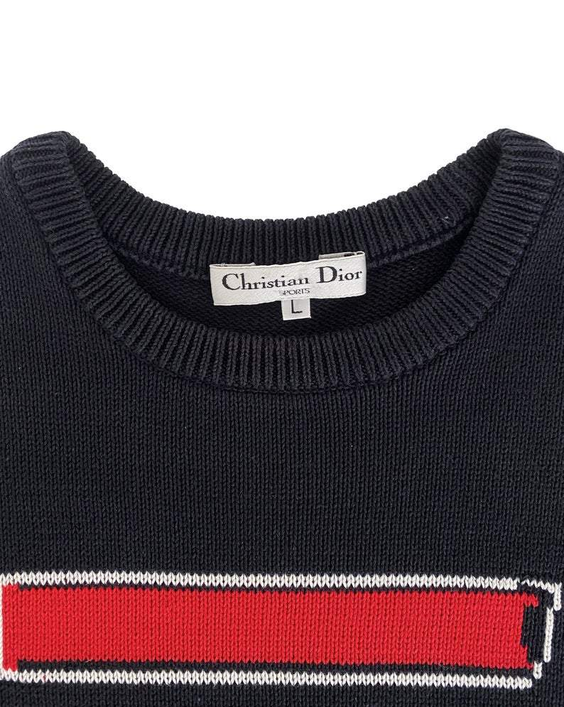 Fruit Vintage 1980s Christian Dior Sports Logo Knitted sweater. It features a large embroidered logo design at front and classic sweater knit cut.