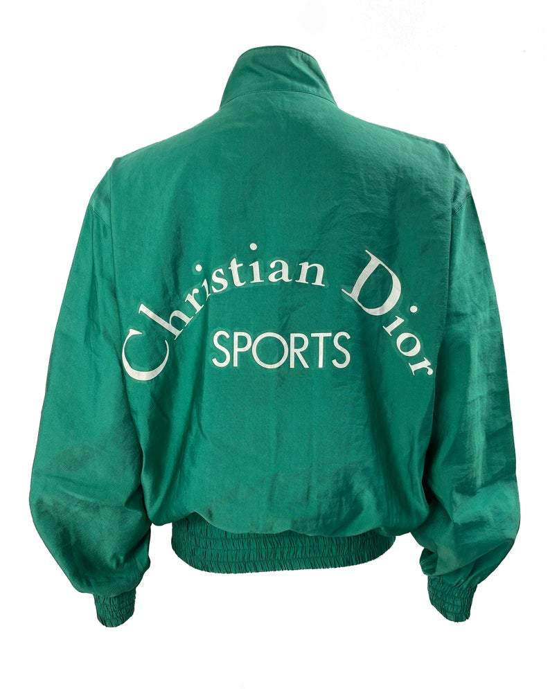 FRUIT vintage rare Christian Dior Sports Green Logo bomber jacket from the 1980s. It features a classic 1980s bomber jacket cut, and large Christian Dior Sport text logo printed at rear.