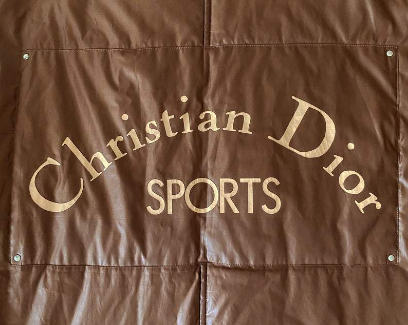 FRUIT vintage Christian Dior Sport Brown Logo puffer coat from the 1980s. It features a classic 1980s bomber style and large Christian Dior Sport text logo printed at rear.