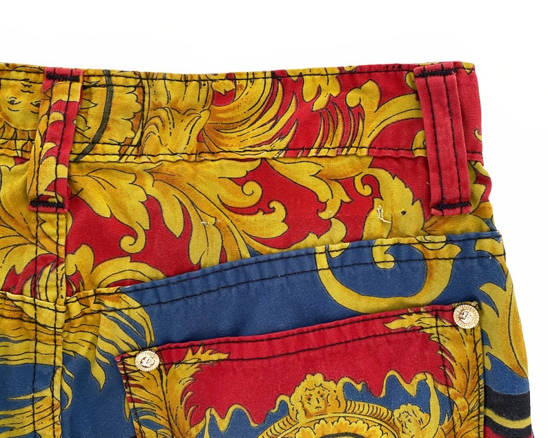FRUIT Vintage Versace pants from the Jeans Couture collection. This is a lifetime Gianni Versace piece from the 1990s, it features the iconic 'Baroque' Print with Miami palms at the rear.