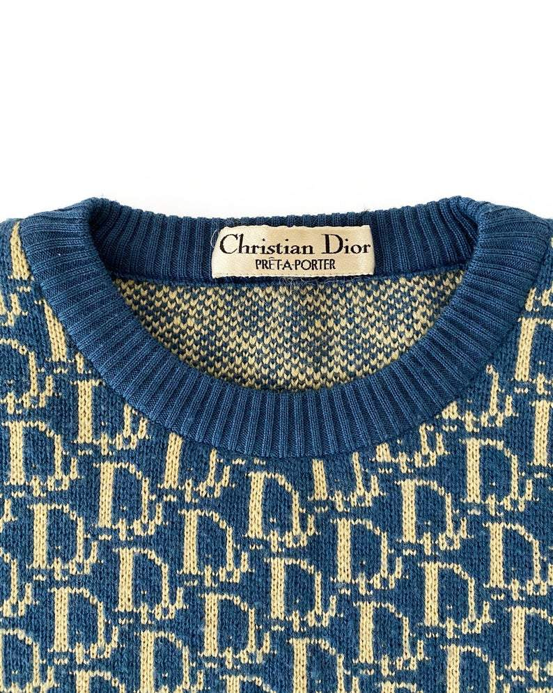Fruit Vintage 1980s Christian Dior rare navy logo knit sweater. It features the iconic oblique print knitted into the weave of the fabric all over and a classic sweater cut.