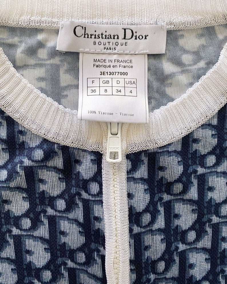 Fruit Vintage Christian Dior oblique logo zipper knit is about as iconic as it gets. Inspired by the original Dior trotter monogram canvas luggage and accessories, and re-released under the creative direction of John Galliano.