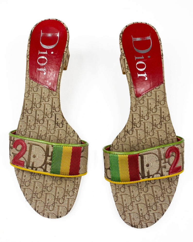 Fruit Vintage Christian Dior rasta logo kitten heel mules in monogram canvas. They feature the iconic Dior number in leather appliqué and racing stripes in cotton twill.