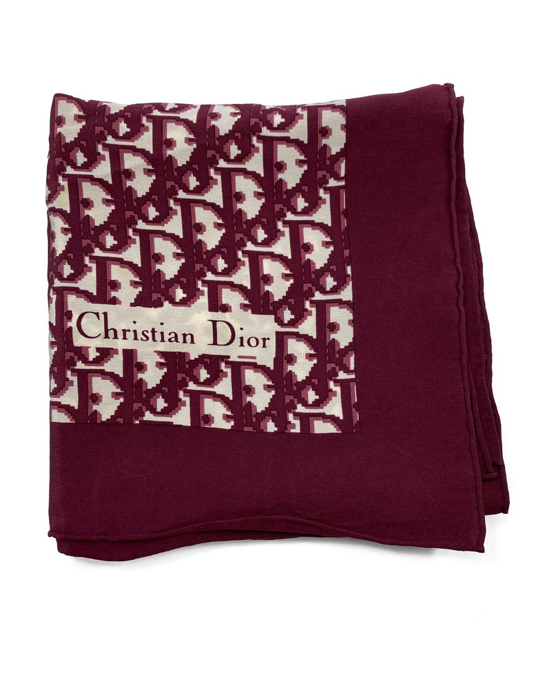 Fruit Vintage Christian Dior oblique print silk scarf, perfect for use as a hair accessory, to tie around a hat or even wear as a handkerchief top. Features a bold graphic Dior logo print and hand finished rolled hem edging.