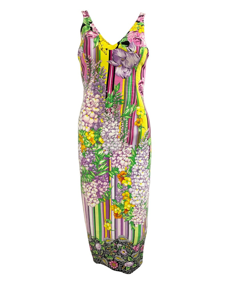 FRUIT Vintage Versus Versace dress designed by Gianni Versace in the 1990s. This graphic, floral print midi dress features a bold pattern on pattern print of floral and tailored cut.